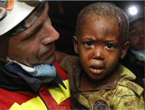 Image of a Haiti earthquake victim and resque worker.